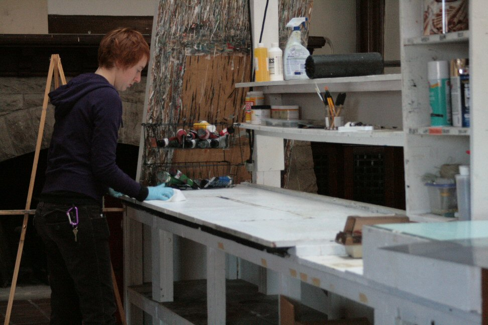 Mary Beth starts work on another table