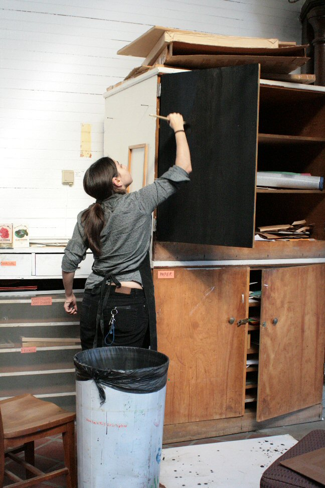 Teresa paints the cabinet for use as a blackboard
