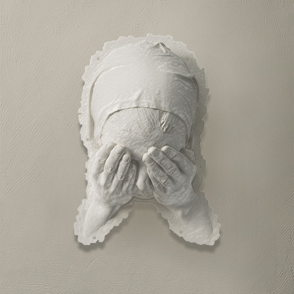"""Mask"" by Virginia Maksymowicz, life-size paper sculpture."